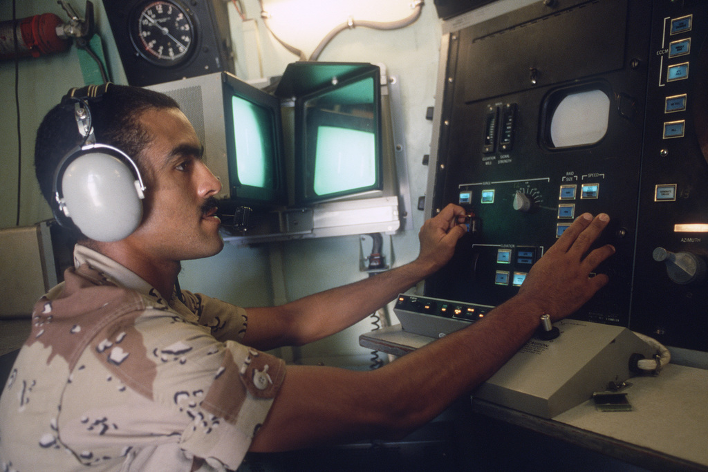 An operator monitors a console in the command and control center of an MIM-23 Hawk surface-to-air missile site during the multinational joint service Exercise BRIGHT STAR '85