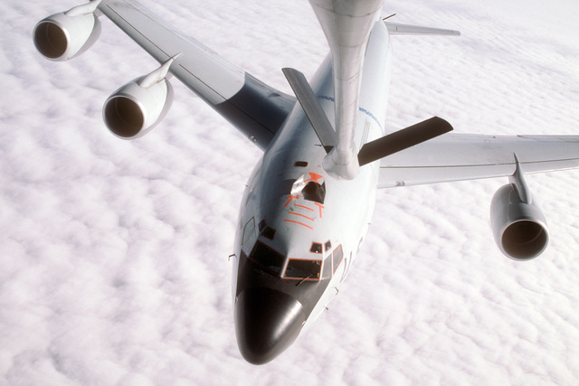 Boom operator's view of a 384th Air Refueling Squadron KC-135R Stratotanker aircraft breaking away from the refueling boom of another KC-135R Stratotanker aircraft