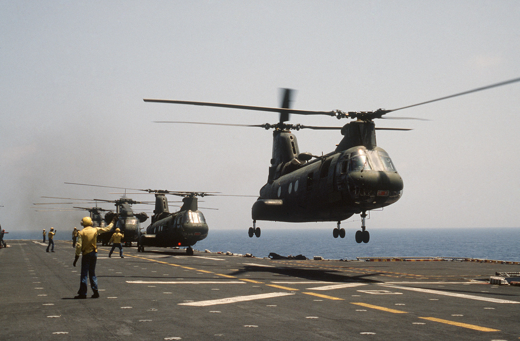 CH-46 Sea Knight and CH-53 Sea Stallion helicopters take off from the amphibious assault ship USS IWO JIMA (LPH 2) during the multinational joint service Exercise BRIGHT STAR '85