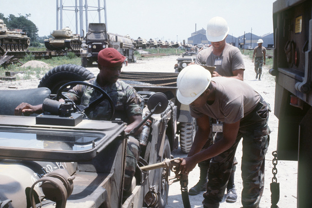 M-151 light vehicles are fueled at the Wilmington Port Authority prior to being loaded aboard a ship for transport to Egypt for the multinational joint service Exercise BRIGHT STAR '85