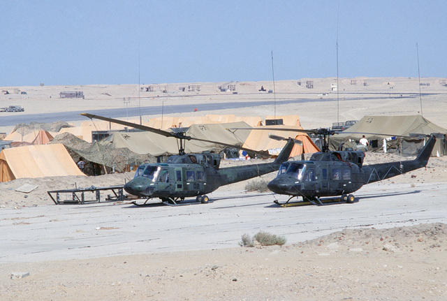 Two U.S. Marine Corps UH-1N Iroquois helicopters parked on the flight line during the multinational joint service Exercise BRIGHT STAR '85