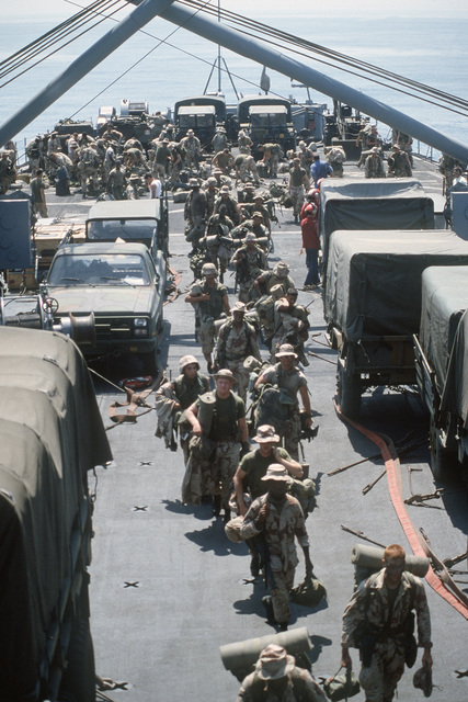 U.S. Marines aboard the tank landing ship USS LA MOURE COUNTY (LST 1194) unload equipment after returning from an exercise in the Egyptian desert during the multinational joint service Exercise BRIGHT STAR '85