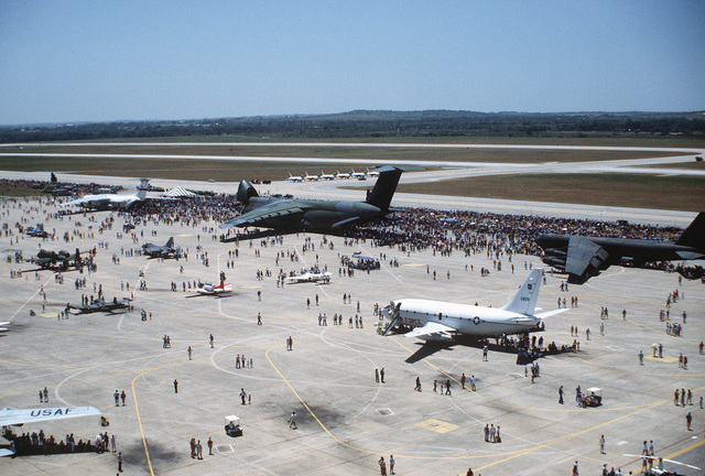 An overall view of visitors examining various US Air Force aircraft on display on the flight line during Aerofest open house