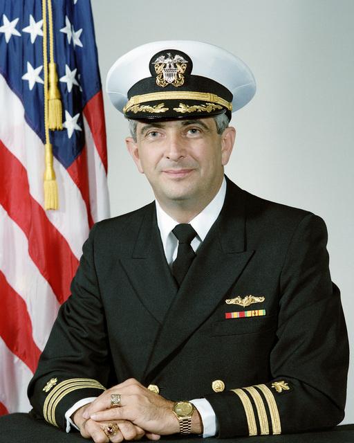 Commander (CDR) Louis D. Storm, USN (covered)