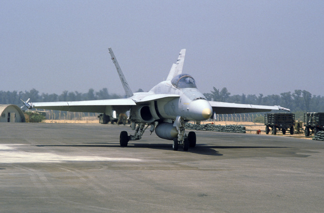 An F/A-18A Hornet aircraft from Marine Fighter Attack Squadron 531 (VFMA-531), Marine Air Group 11 (MAG-11), taxis along the flight line during the multinational joint service Exercise BRIGHT STAR '85