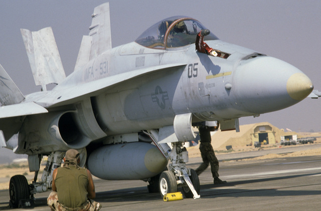 An F/A-18A Hornet aircraft from Marine Fighter Attack Squadron 531 (VFMA-531), Marine Air Group 11 (MAG-11), is serviced on the flight line during the multinational joint service Exercise BRIGHT STAR '85
