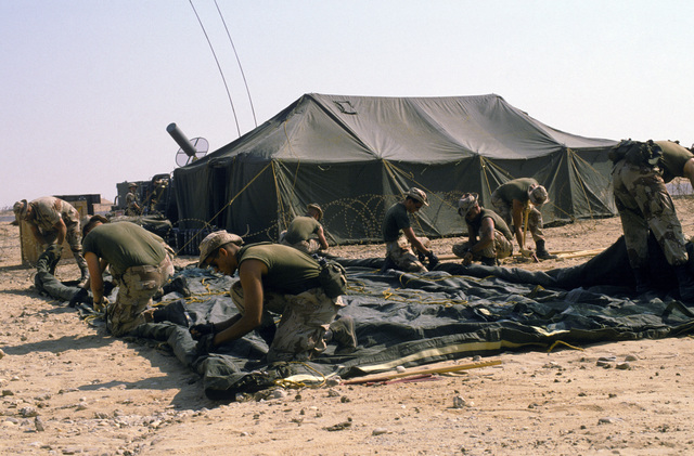 U.S. Marines construct a base camp for support in deploying F/A-18A Hornet aircraft during the multinational joint service Exercise BRIGHT STAR '85
