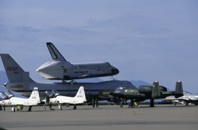 A NASA Boeing 747 carrier aircraft transporting the space shuttle orbiter Challenger parked on the apron for refueling. The shuttle is en route to Cape Canaveral, Florida