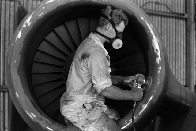 SENIOR Airmen (SRA) Michael J. Griffin sands the engine housing of an A-10A Thunderbolt II prior to painting the aircraft as part of a corrosion control program