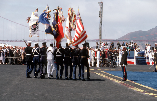 A joint services color guard aboard the nuclear-powered aircraft carrier USS ENTERPRISE (CVN 65) participates in the Peace in the Pacific celebration commemorating the 40th anniversary of the end of the war with Japan