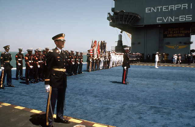 A joint services honor guard stands at parade rest aboard the nuclear-powered aircraft carrier USS ENTERPRISE (CVN 65) during the Peace in the Pacific celebration commemorating the 40th anniversary of the end of the war with Japan