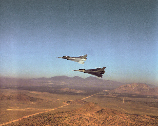 An air-to-air left side view of two F-16XL Fighting Falcon aircraft in formation while undergoing stability and control testing