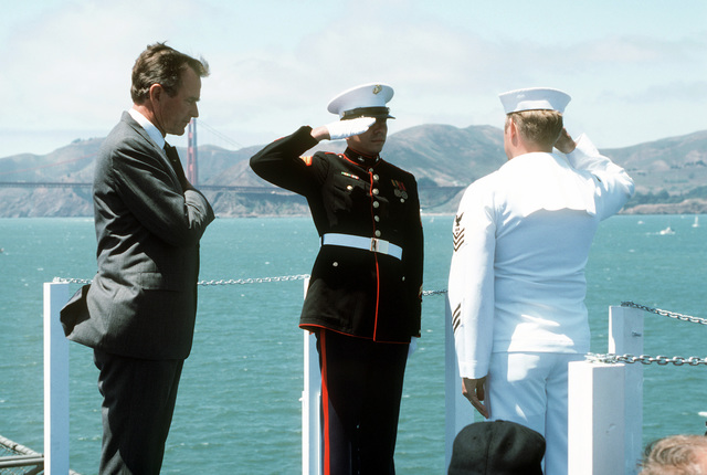 Honors are rendered by Vice President George Bush and a joint Marine/Navy honor guard after a wreath is thrown into the water during the Peace in the Pacific celebration commemorating the 40th anniversary of the end of the war with Japan. The ceremony is being held aboard the nuclear-powered aircraft carrier USS ENTERPRISE (CVN 65)