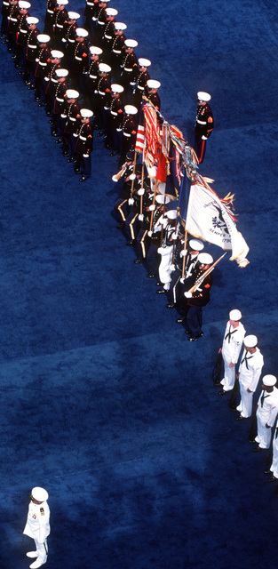 Overhead view of a joint services honor guard participating in the Peace in the Pacific celebration aboard the nuclear-powered aircraft carrier USS ENTERPRISE (CVN 65). The celebration commemorates the 40th anniversary of the end of the war with Japan
