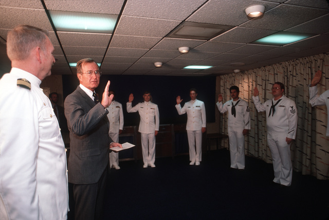 Vice President George Bush reenlists 11 members of the crew aboard the nuclear-powered aircraft carrier USS ENTERPRISE (CVN 65). Vice President Bush is aboard the ENTERPRISE participating in the Peace in the Pacific celebration commemorating the 40th anniversary of the end of the war with Japan