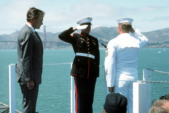 Vice President George Bush watches as a joint Marine/Navy honor guard salute after throwing a wreath into the bay during the Peace in the Pacific celebration commemorating the 40th anniversary of the end of the war with Japan. The ceremony is being held aboard the nuclear-powered aircraft carrier USS ENTERPRISE (CVN 65)