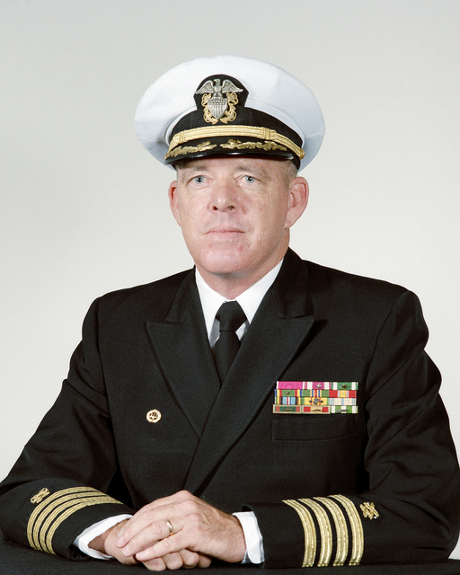 Captain (CAPT) Eric R. Wilson, USN (covered)