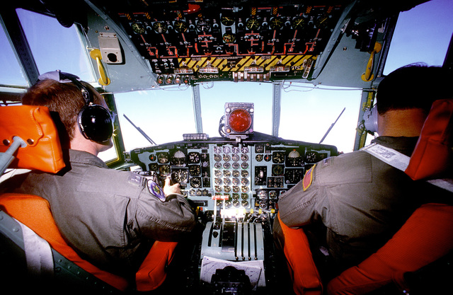 CAPT. Erdie O. Lansford II, pilot, and 1ST LT. Christopher C. Reymann, copilot, both of the 37th Tactical Airlift Squadron, fly a C-130E Hercules aircraft on a container delivery system (CDS) airdrop during a training exercise. Both men are graduates of the U.S. Air Force Academy