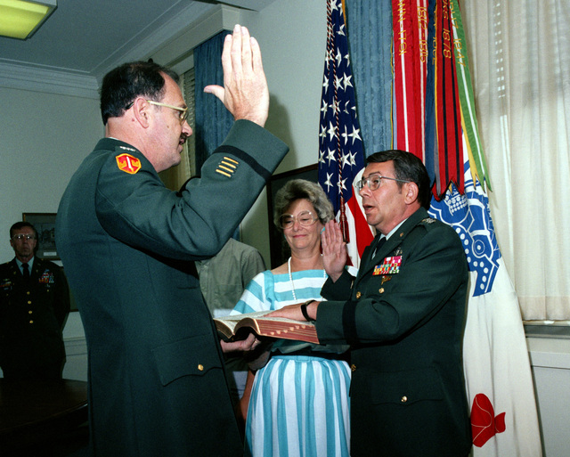 COL John L. McGillen administers the oath of office as LGEN Sidney T. Weinstein assumes the position as the Army's CHIEF of STAFF for Intelligence. Weinstein's wife, Paula, is assisting in the ceremony taking place at the Pentagon