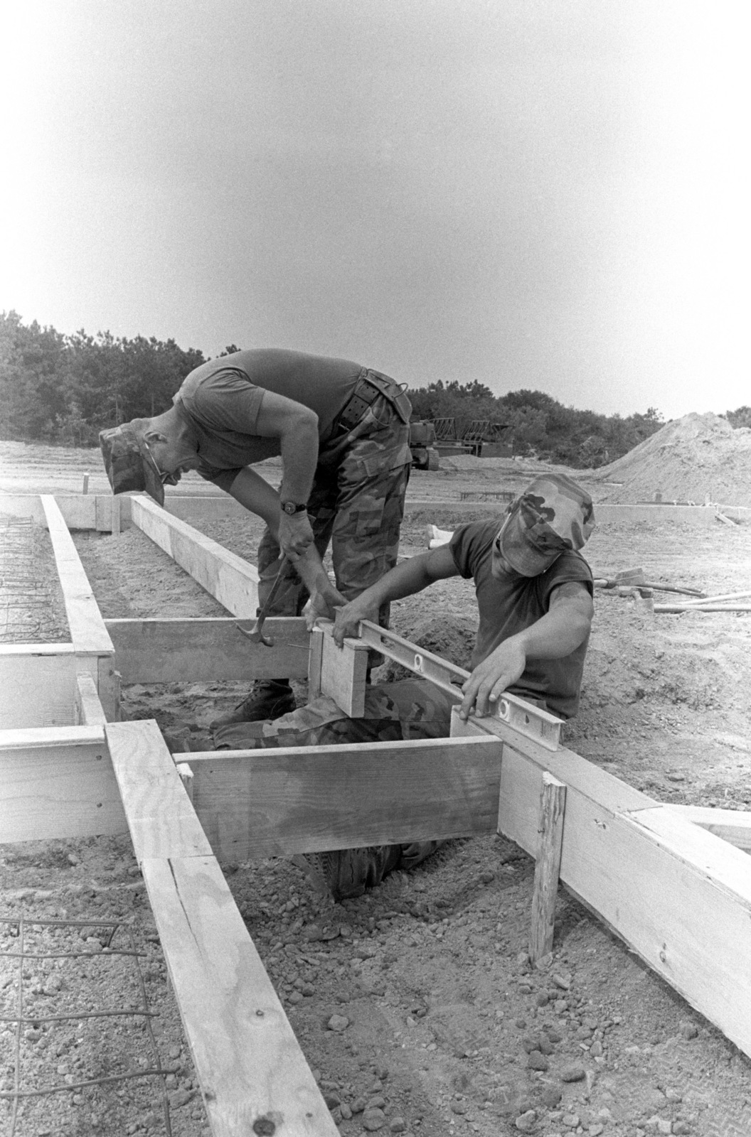 Marines from Detachment A, Wing Engineering Squadron 47, work on the foundation for a radar site