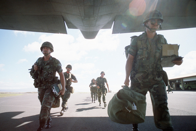 Members of the 29th Brigade, 25th Infantry Division, board a C-130B Hercules aircraft of the 757th Tactical Airlift Squadron, 910th Tactical Airlift Group, Air Force Reserve, during a joint airborne/air transportability training exercise