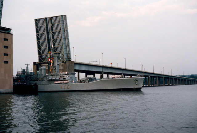 A starboard bow view of the British Leander class frigate HMS ARGONAUT (F 56) passing through the open draw of the Woodrow Wilson Memorial Bridge with her crew manning the rail