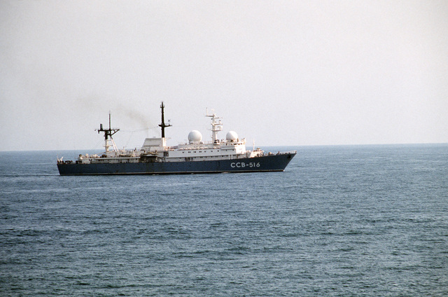 A starboard view of the Soviet Balzam-class general intelligence collector ship underway in international waters as United States Navy ships sail out from Norfolk, Virginia, at the beginning of NATO Exercise OCEAN SAFARI '85