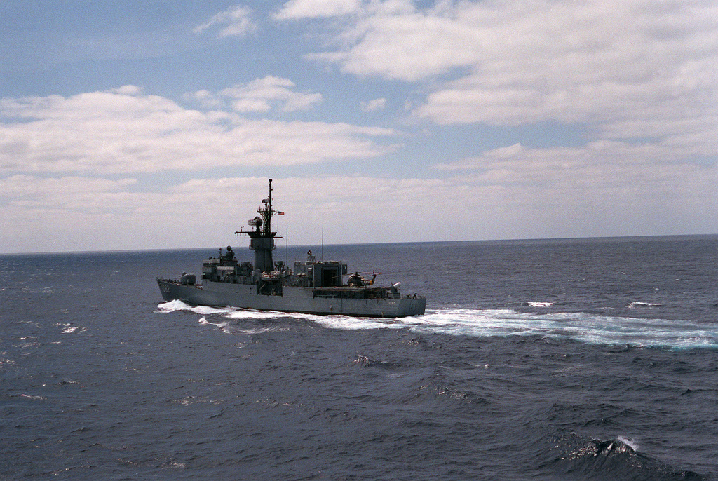 A port quarter view of the frigate USS ELMER MONTGOMERY (FF 1082) underway
