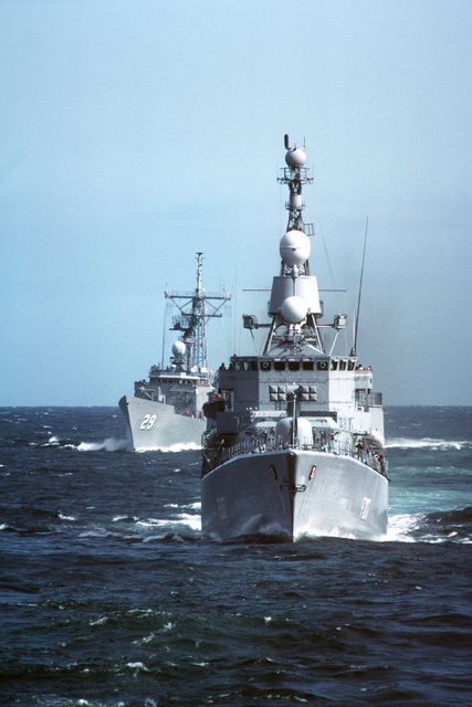A bow view of the French Republic of West Germany frigate BREMEN (F-207) underway during NATO Exercise OCEAN SAFARI '85. The guided missile frigate USS STEPHEN W. GROVES (FFG 29) is in the background
