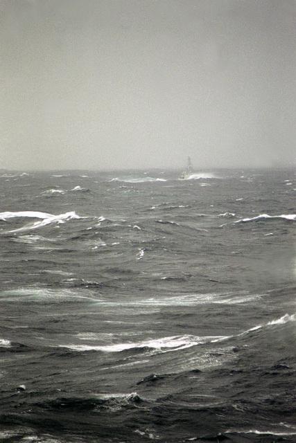 A ship operates in heavy seas during Operation Safari '85