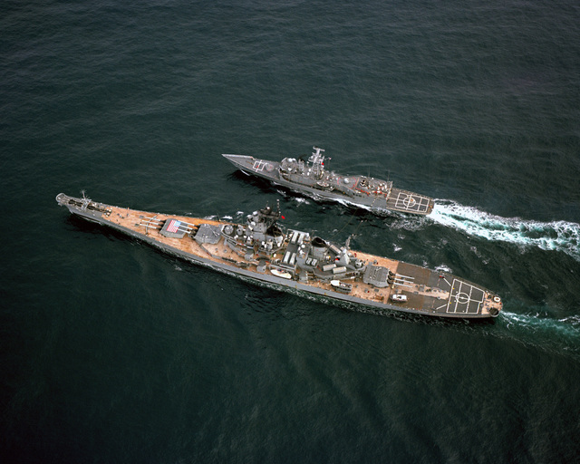 An aerial port quarter view of the battleship USS IOWA (BB 61) refueling the guided missile frigate USS HALYBURTON (FFG 40) during NATO Exercise OCEAN SAFARI '85