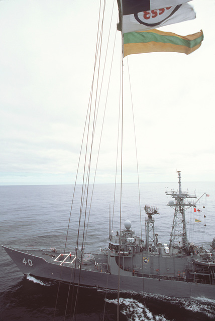 An elevated port bow view, amidships to forward deck, of the guided frigate USS HAYLBURTON (FFG 40) underway during NATO Exercise OCEAN SAFARI '85
