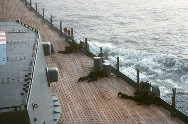 Crewmen aboard the battleship USS IOWA (BB 61) participate in a self defense force test during Exercise OCEAN SAFARI '85