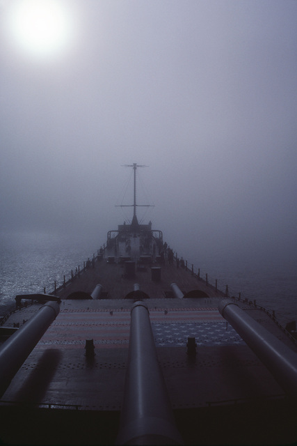Fog shrouds the bow of the battleship USS IOWA (BB 61) during Exercise OCEAN SAFARI '85