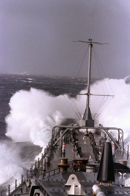 The battleship USS IOWA (BB-61) takes water over the bow while underway in heavy seas during exercise Ocean Safari '85