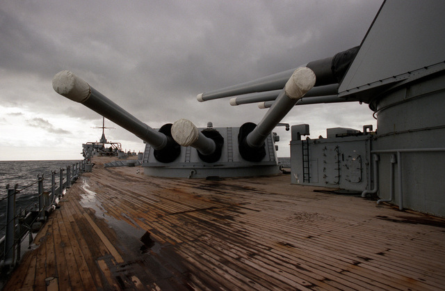 The No. 1 Mark 7 16-inch/50-caliber gun turret aboard the battleship USS IOWA (BB-61) is trained aft on the port side during exercise Ocean Safari '85
