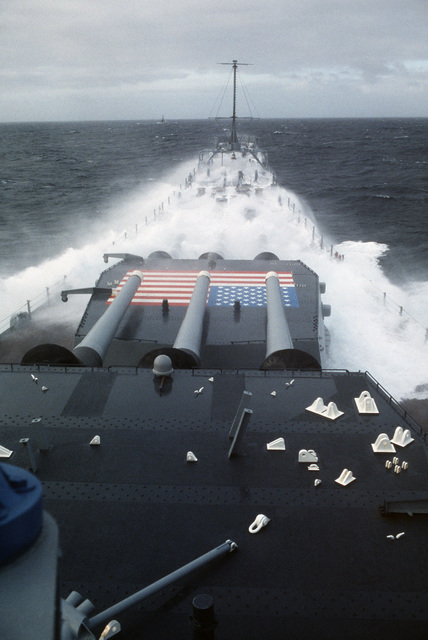 Waves crash on the bow of the battleship USS IOWA (BB 61) while underway in rough seas. The ship is participating in NATO Exercise OCEAN SAFARI '85