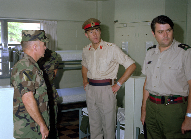 MAJ. GEN. Cooper, second from right, of the British Royal Armoured Corps tours a barracks during his visit to the U.S. Army Armor Center