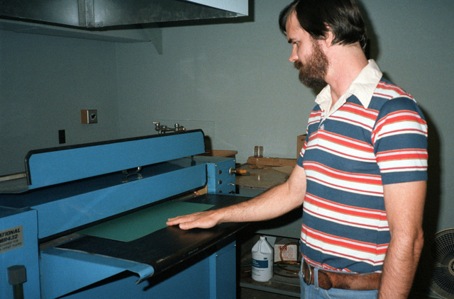 David Moore makes plates in the Field Printing Plant
