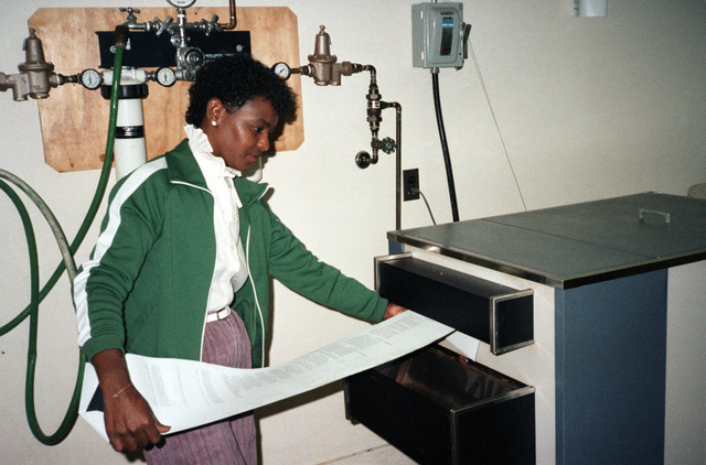 Magaline Jordan works in the composition section of the Field Printing Plant