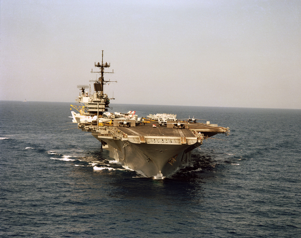 A bow view of the aircraft carrier USS SARATOGA (CV 60), with F-14A Tomcat aircraft at three catapults
