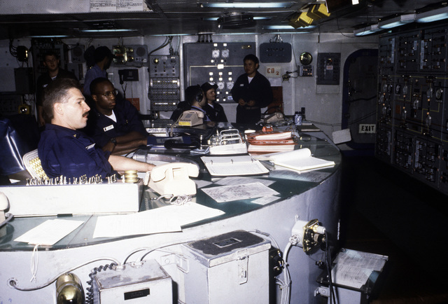 Electrician Mates monitor the main electrical control console in the engineering spaces on board the Forrestal Class, Aircraft Carrier USS SARATOGA (CV 60)