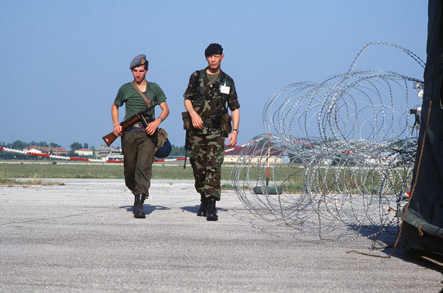 A US AIRMAN and an Italian soldier patrol the perimeter of the 6913th Electronic Security Command deployment site erected during Exercise DISPLAY DETERMINATION '85