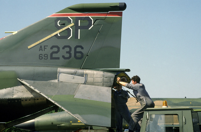 Belgium ground crewmen reload a drag chute onto a US Air Force F-4G Phantom II Advanced Wild Weasel aircraft during a joint service exercise