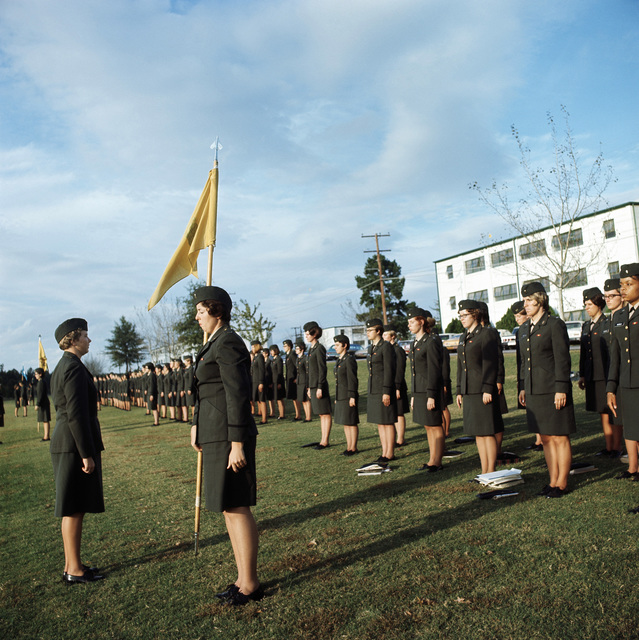 Female US Army officers stand in formation