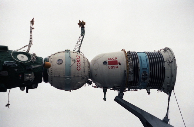 Model of a Soyuz spacecraft docking with the Salyut-7 space station. The display is in front of one of the pavilions of the Exhibition of Soviet National Economic Achievement