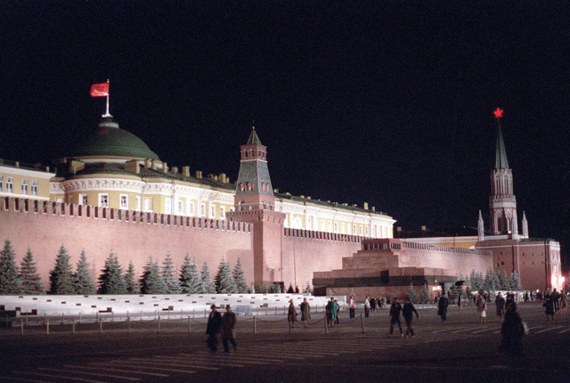 A nighttime view in Red Square showing the Lenin Mausoleum. Behind the mausoleum is the Kremlin Wall and beyond that is the building of the Council of Ministers of the USR (formerly the Senate). This is the seat of the Soviet government