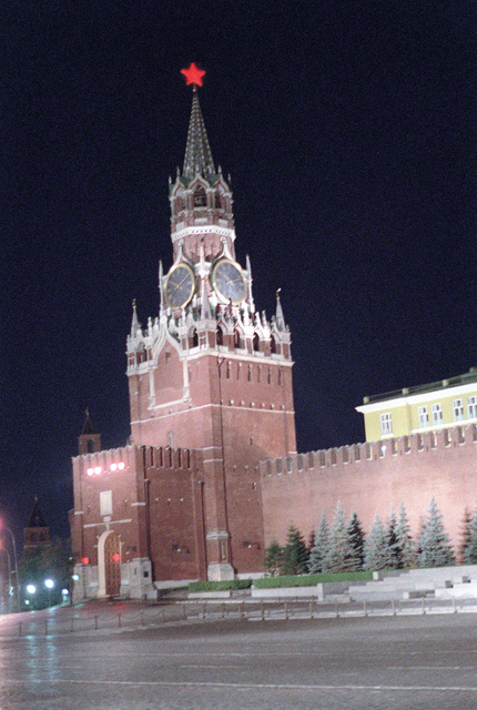 A nighttime view in Red Square showing the Savior Tower located on the south end of the Kremlin Wall. It is through this gate that members of the Soviet government enter the Kremlin