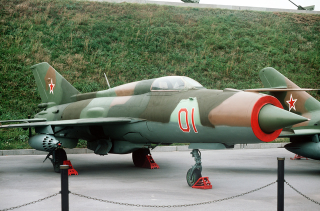 Right front view of a Soviet MiG-21 Fishbed fighter aircraft showing an UV-16 rocket pod attached to the wing pylon. The aircraft is on public display at the Memorial Complex of the Ukrainian State