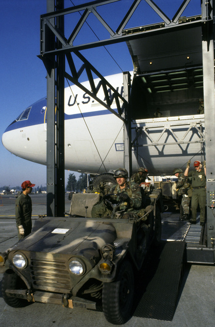 An M151A1 light vehicle is driven onto a lift to be loaded aboard a KC-10A Extender aircraft during an operational readiness inspection. The vehicle will be transported to Davis Field, Oklahoma